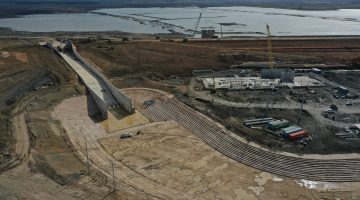 View of the dam and reservoir construction as of late March 2021